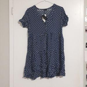 White polka dots, dark blue dress.